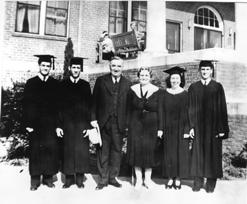 Left to right — Graduates with Dr. and Mrs. Forrest